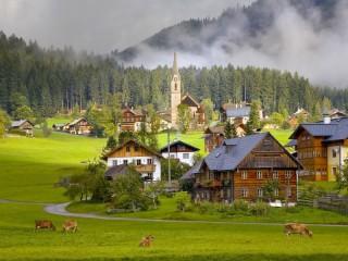 Собирать пазл Austria village forest онлайн